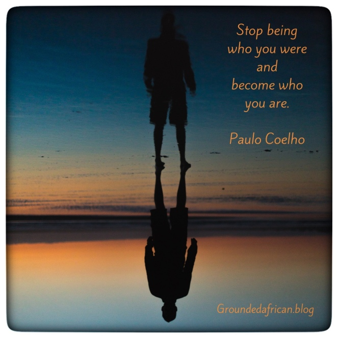 Man with shadow behind him in lake . Quote by Paulo Coelho