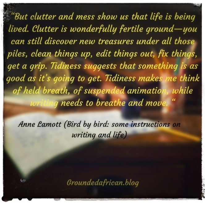 Mildly cluttered desk with Quote by Anne Lamont extracted from her book, bird by bird