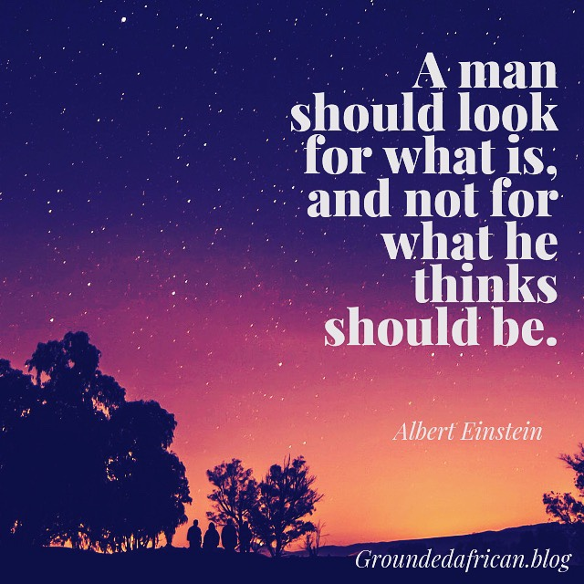 A dawn sky with stars and quote by Albert Einstein