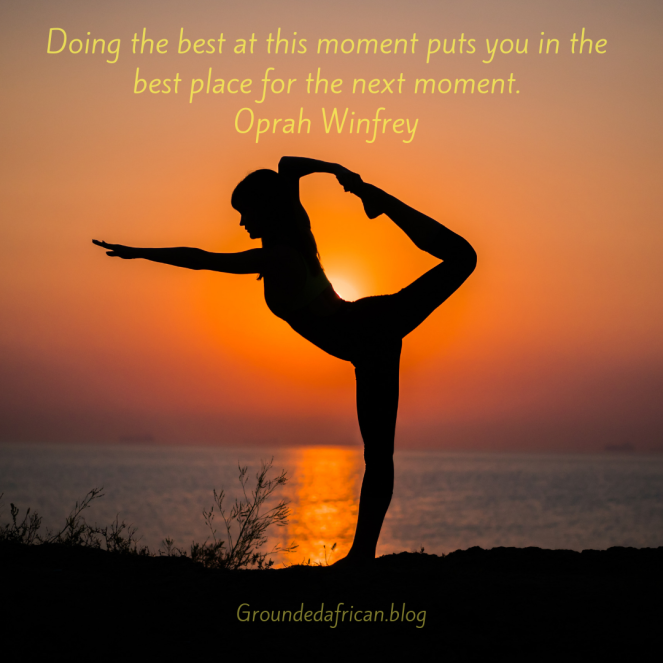 Woman doing yoga pose with the rising sun as a backdrop. Quote by Oprah Winfrey