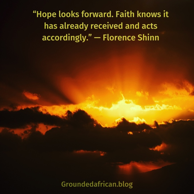 Sun's rays behind a bank of clouds at sunrise. Quote by Florence Shinn