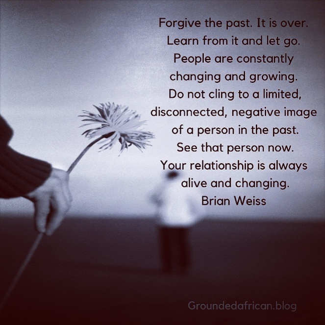 Woman holding flower behind man. Quote by Brian Weiss