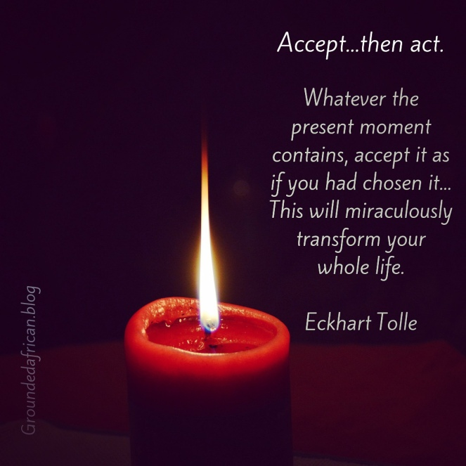 Red candle burning. Dark background. Quote by Eckhart Tolle