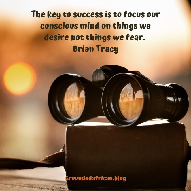 Binoculars resting on case. Quote by Brian Tracy