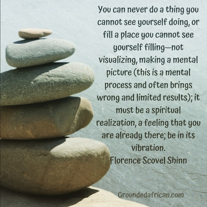 Balancing stones against a watery background. Quote by Florence Scovel Shinn