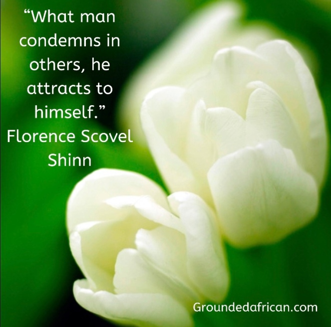 White tulips against a green backdrop. Quote by Florence Scovel Shinn