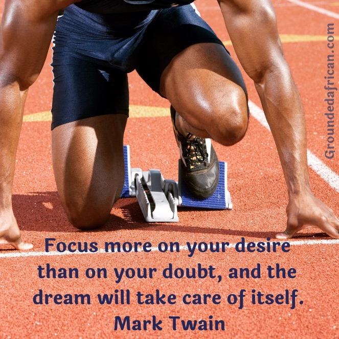 Male athlete in starting blocks. Quote re: focus by Mark Twain