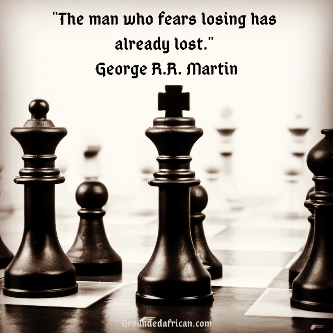 Chess pieces on a board. Quote by George R.R. Martin