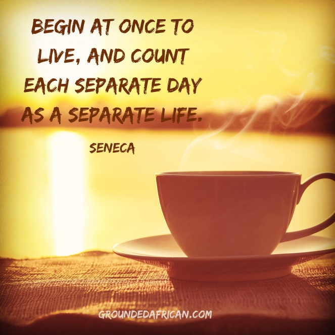 Cup of coffee on table. Sunrise in background. Quote by Seneca