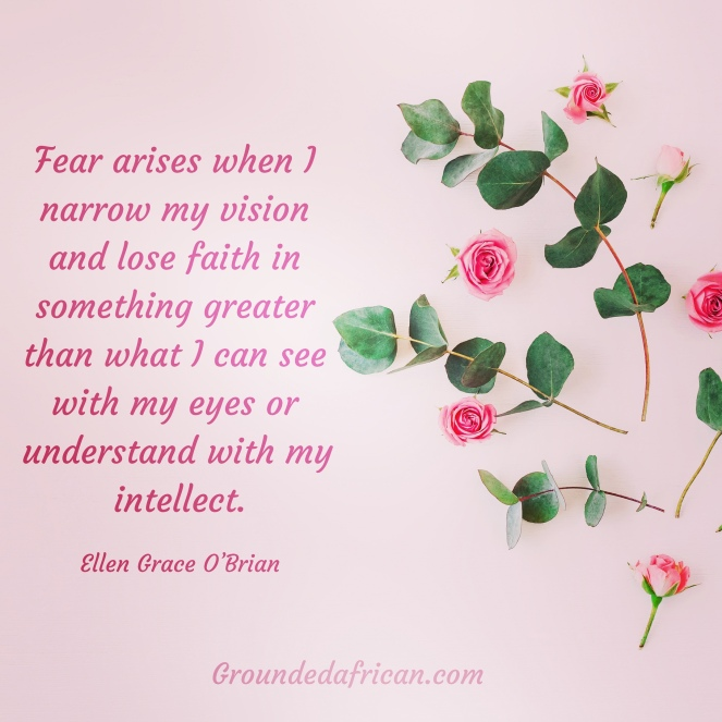Pink roses scattered on a pink background. Quote about fear