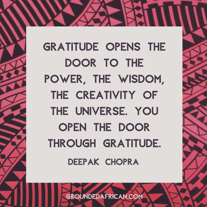 Quote about gratitude by Deepak Chopra in a white square over pink African print