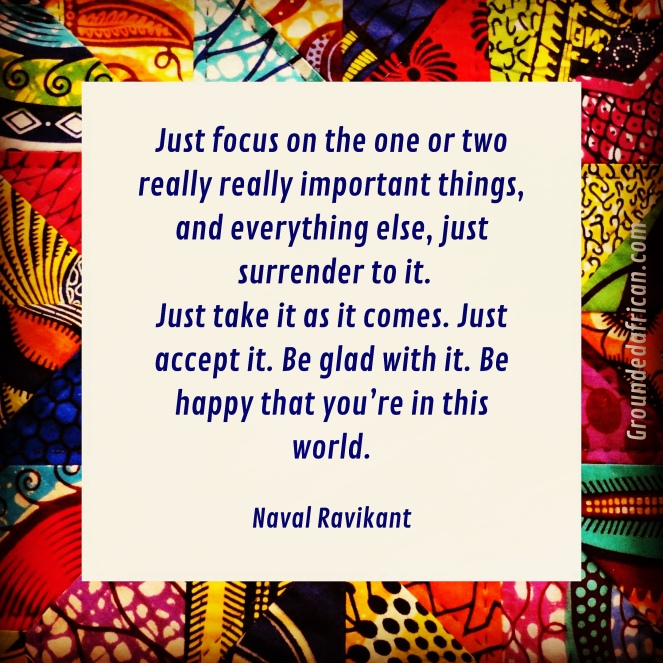 Quote by Naval Ravikant on a white square over an African print