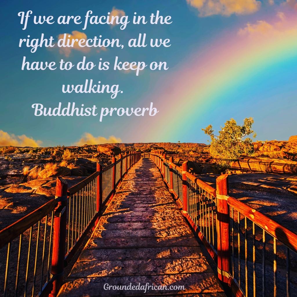 Pathway leading to rainbow on horizon